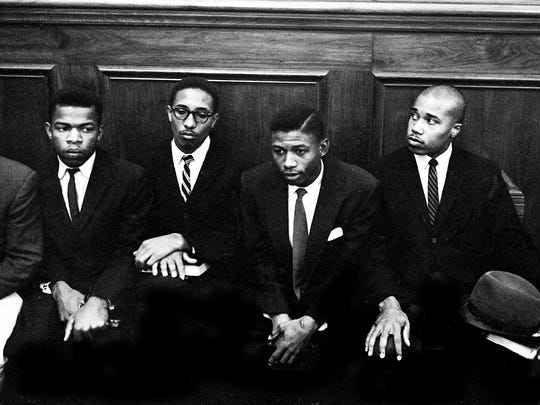 John Lewis, left, and three fellow sit-in demonstrators sit in a courtroom of the Nashville Court House Nov. 21, 1960, involving another trial on their protesting at the lunch counters in downtown Nashville.