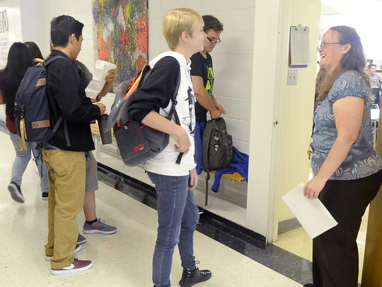 First-year English teacher Amber Ayers (right) talks with students at Yerington High School.