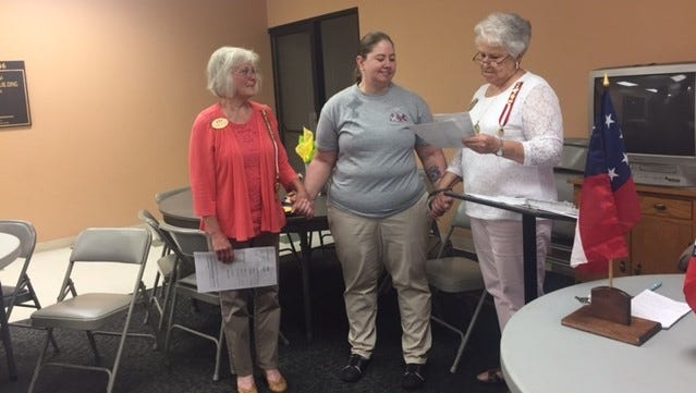 The Caroline Meriwether Goodlett chapter of the United Daughters of the Confederacy recently welcomed Julie Little as a new member. Shown are Dianne Freeman registrar, from left, Little andJanice Hamann, president.