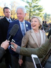 Former President Bill Clinton and Hillary Clinton greet the crowd at the Douglas Grafflin Elementary School in Chappaqua, after casting their vote Nov. 8, 2016.