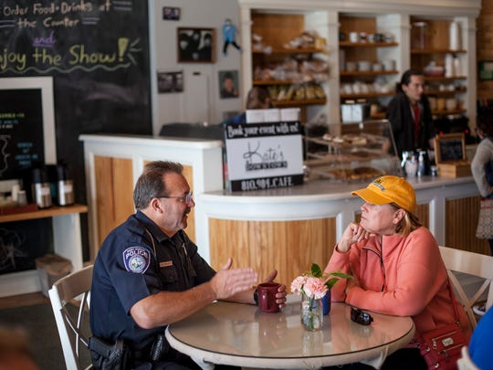 Port Huron Police Officer Dave Conley chats with Sandy White, of Burtchville Township, during Coffee with a Cop Friday, Oct. 7, 2016 at Kate's Downtown in Port Huron.