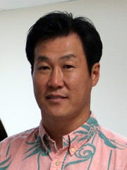 John S. Ko, President of NET Enterprises INC