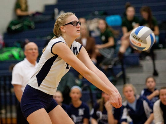 Marysville senior Payton Husson bumps the ball during a regional semifinal volleyball game Tuesday, November 10, 2015 at Imlay City High School.
