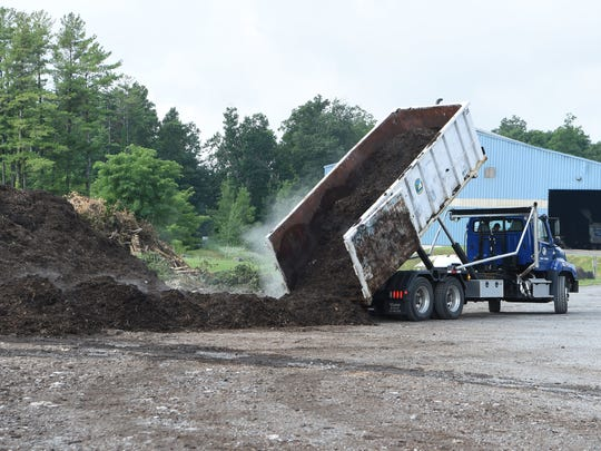 A truck dumps wood chips at the Ulster County Resource Recovery Agency in the Town of Ulster. The wood chips are combined with food waste to become compost.