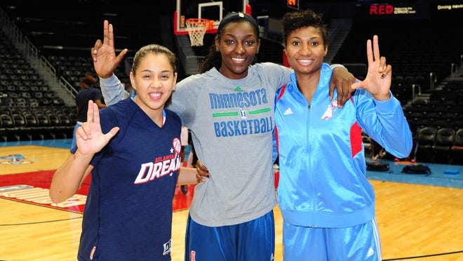Atlanta Dream teammates Shoni Schimmel, left, and Angel McCoughtry, right, pose with fellow former Louisville Cardinal Asia Taylor of the Minnesota Lynx before their June 13 game at Phillips Arena.