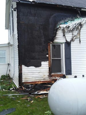 Lightning struck very close to this propane tank at the home of Lovina's sisters, Verena and Susan.