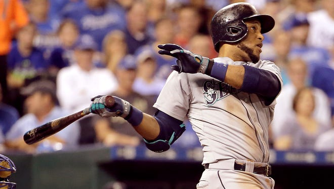 Seattle Mariners' Robinson Cano hits a three-run home run during the third inning of a baseball game against the Kansas City Royals, Tuesday, Sept. 22, 2015, in Kansas City, Mo.