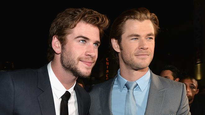 """HOLLYWOOD, CA - NOVEMBER 04:  Actors Liam Hemsworth (L) and Chris Hemsworth attend Marvel's """"Thor: The Dark World"""" Premiere at the El Capitan Theatre on November 4, 2013 in Hollywood, California.  (Photo by Alberto E. Rodriguez/WireImage) ORG XMIT: 182910241 ORIG FILE ID: 186903531"""