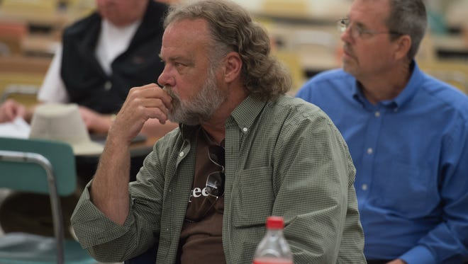 Sugarcreek Packing Co. representative Ed Rodden listens during a public meeting about the Western Wayne Regional Sewer District on May 16, 2017 at Lincoln High School in Cambridge City, Ind.