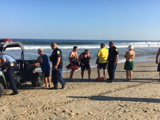 Members of the Belmar Rescue Team, center, after pulling