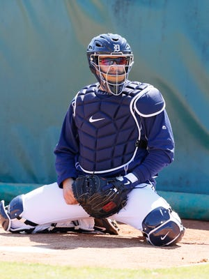 Detroit Tigers catcher Alex Avila stretching as he gets ready to catch pitchers in the bullpen Feb. 20, 2015, in Lakeland, Fla.