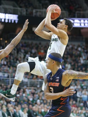 Michigan State Spartans Bryn Forbes scores against the University of Illinois Khalid Lewis during first half action on Thursday, January 7,2015 at the Breslin Center in East Lansing Michigan.