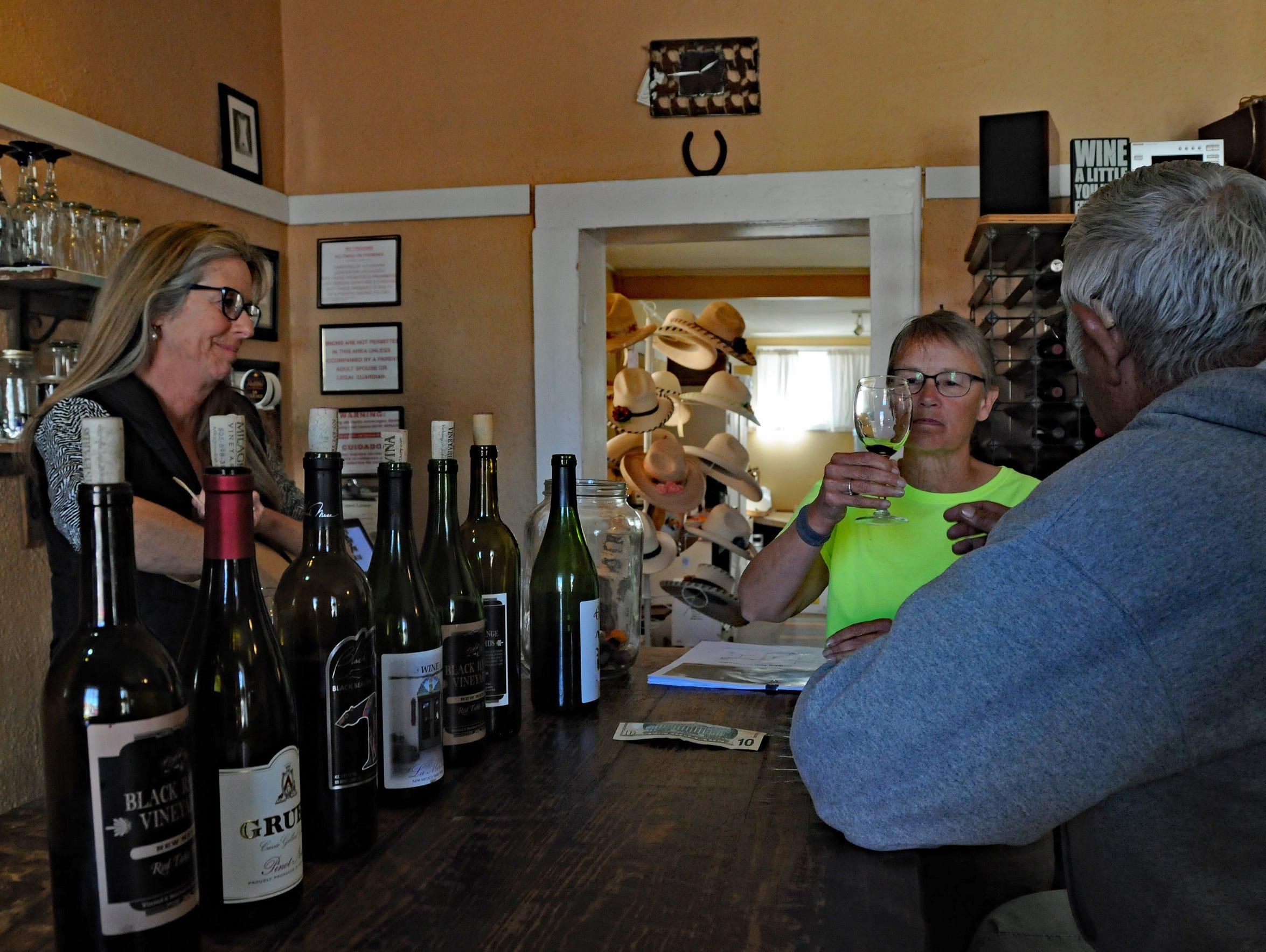 Barb Payla of Minnesota samples wine at the Black Range