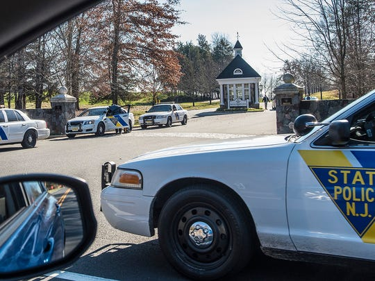 New Jersey State Police cars line the roadways before the meeting to discuss President-elect Trump's cabinet jobs at the Trump National Golf Club in Bedminster, Nov. 19, 2016.