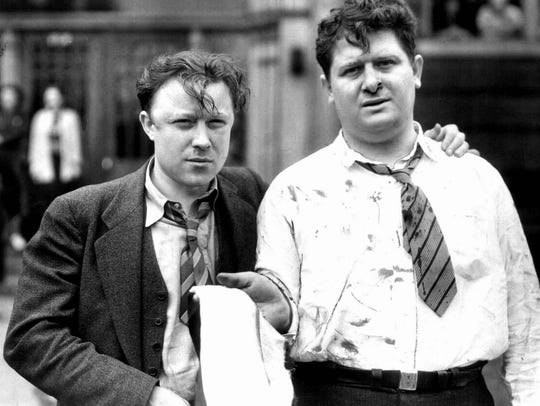 Bloodied labor heroes Walter Reuther and Richard  Frankensteen