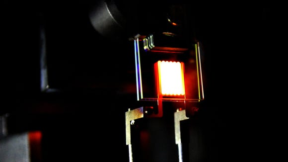 """A """"proof-of-concept"""" device built by MIT researchers demonstrates the principle of a two-stage process to make incandescent bulbs more efficient. This device already achieves efficiency comparable to some compact fluorescent and LED bulbs."""