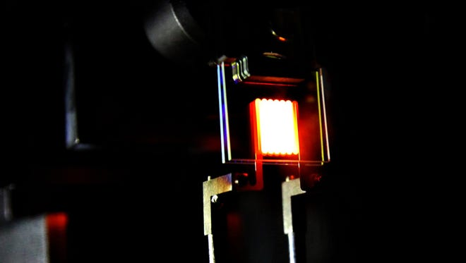 "A ""proof-of-concept"" device built by MIT researchers demonstrates the principle of a two-stage process to make incandescent bulbs more efficient. This device already achieves efficiency comparable to some compact fluorescent and LED bulbs."