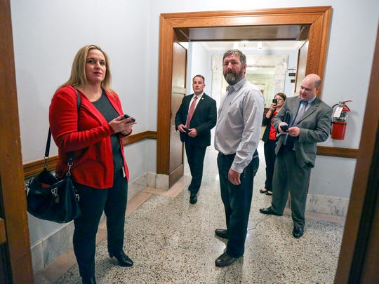 Joanna Decker, left, aid to Sannie Overly and majority caucus chair for House Democrats and Johnny Bell, right, D-Glasgow, were not allowed to enter the press conference that Governor Bevin held to speak about Benefind.