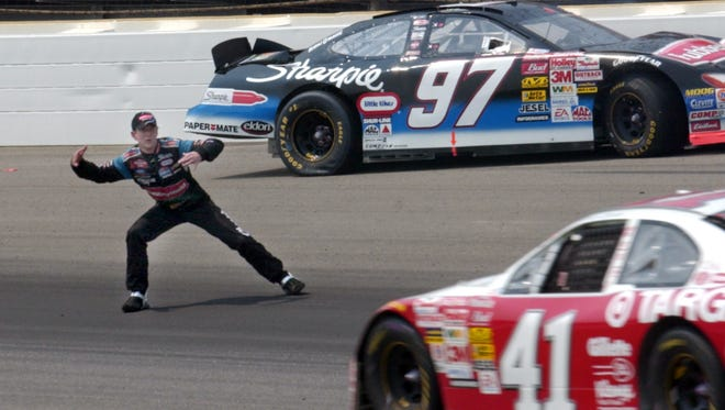 Kurt Busch shows his displeasure with fellow driver Jimmy Spencer (41) after crashing in Brickyard 400 at Indianapolis Motor Speedway in 2002.