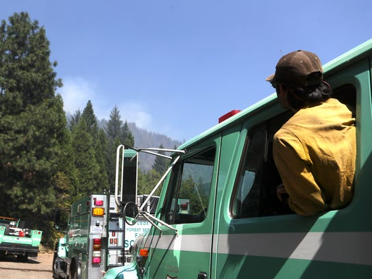 U.S. Forest Service firefighter Cesar Gonzales keeps