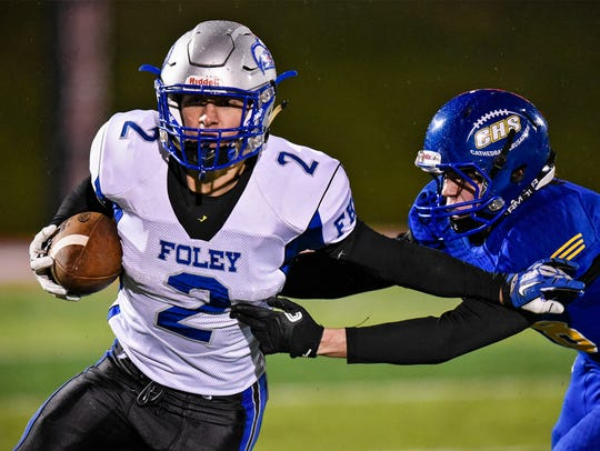 Foley's Hunter Beehler carries the ball during the