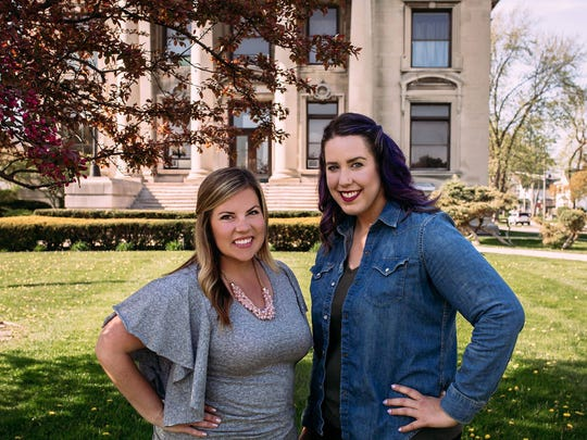 From left, Courtney Westendorf and Megan Block-Brewer stand in front of their new office in the Ladies of the Maccabees Building in Port Huron.