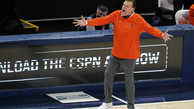 Illinois head coach Brad Underwood argues a call during the second half of an NCAA college basketball game against Baylor, Wednesday, Dec. 2, 2020, in Indianapolis.
