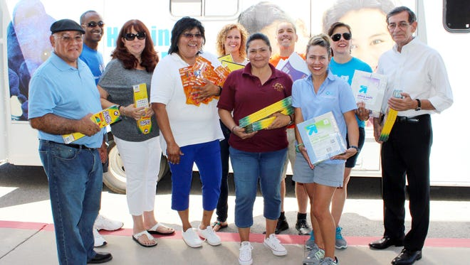 District officials accept school supplies donated to Las Cruces Public Schools by Blue Cross Blue Shield of New Mexico.