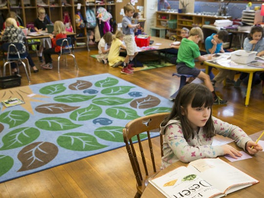 First graders work on coursework at IPS School 84,