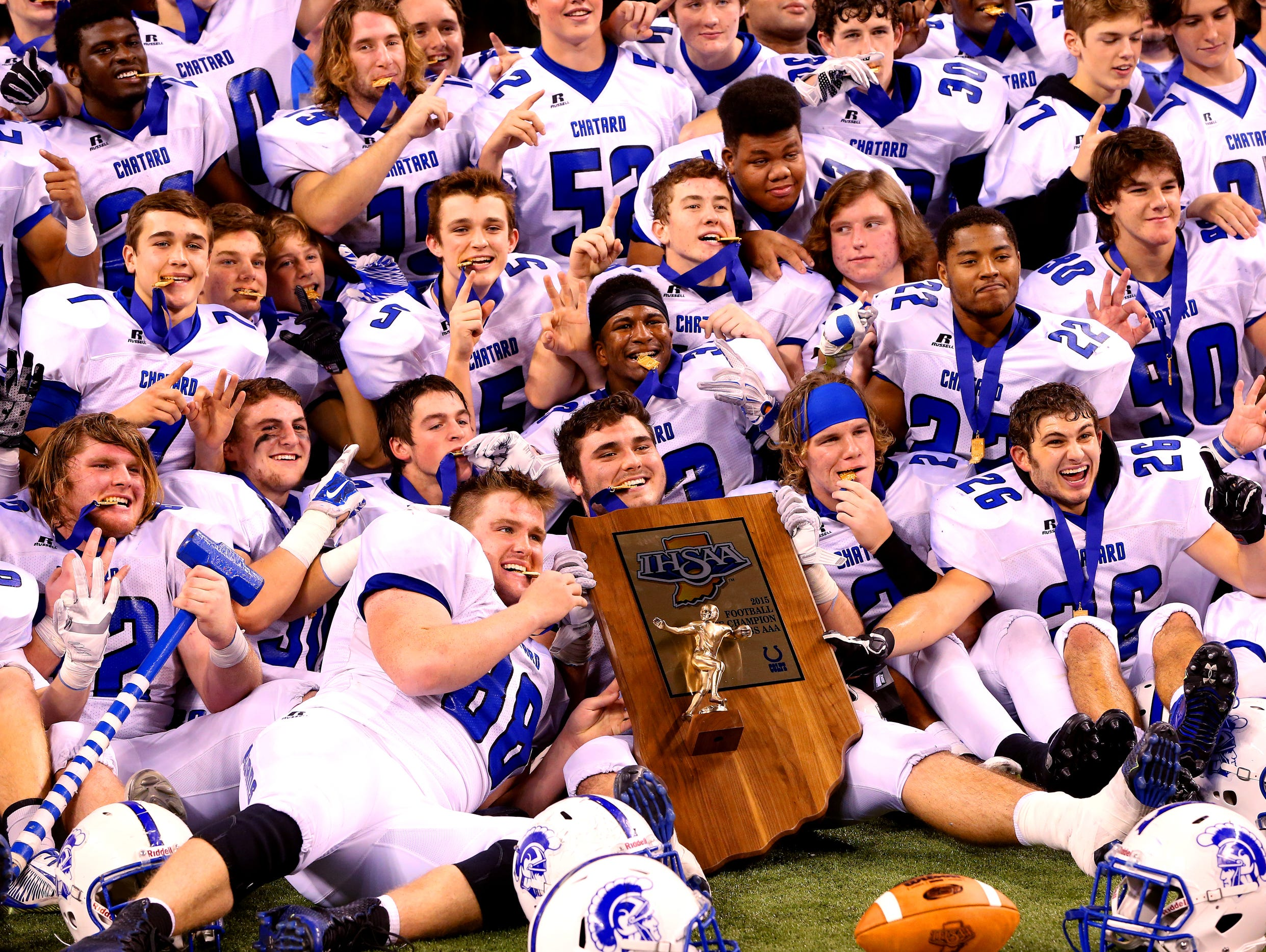 The Bishop Chatard Trojans celebrate after defeating the West Lafayette Red Devils in the Class 3A IHSAA Football State Tournament finals, Nov. 27, 2015.