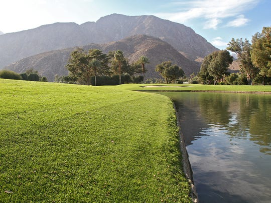 Grass wraps around a pond at De Anza Desert Country Club in Borrego Springs.
