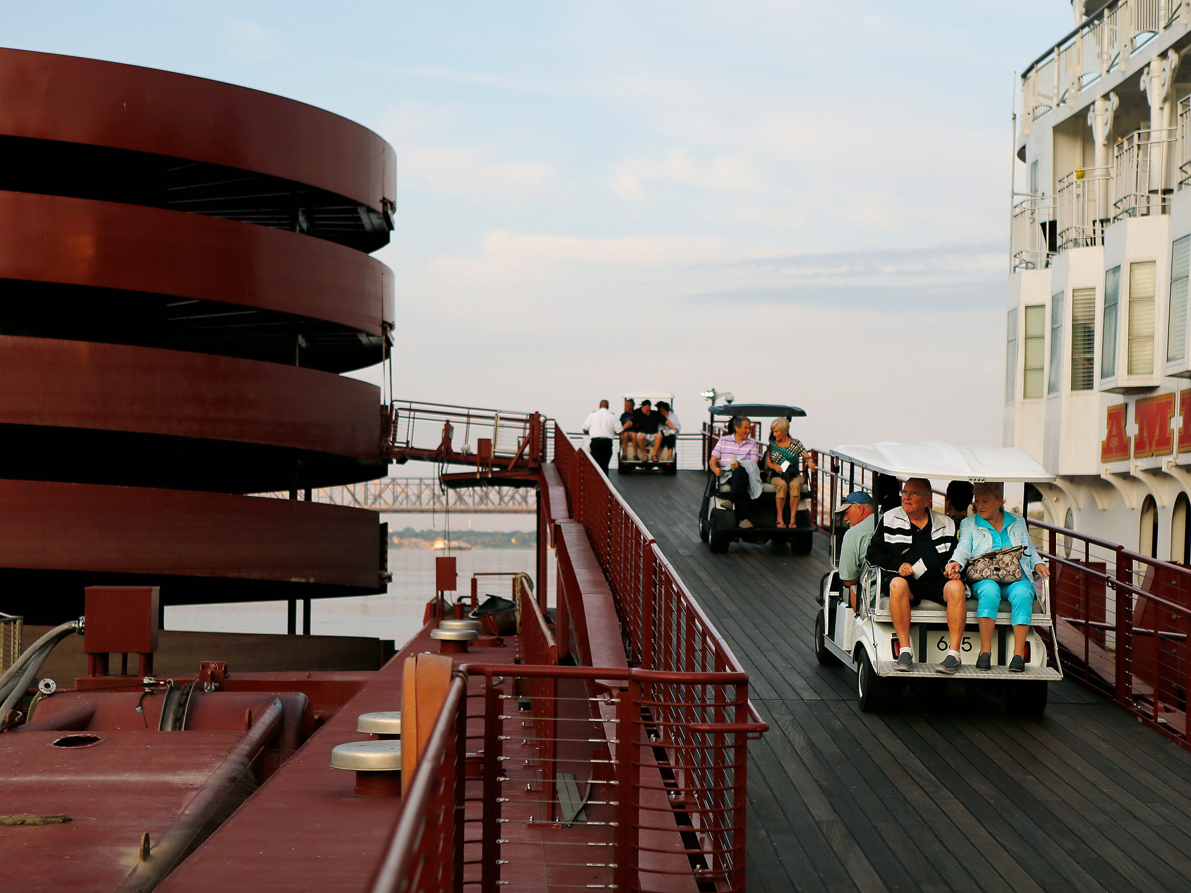 Passengers of the American Queen steamboat are shuttled up the ramp at Beale Street Landing in Memphis. The river boat is estimated to have a nearly $90 million impact on the city of Memphis.