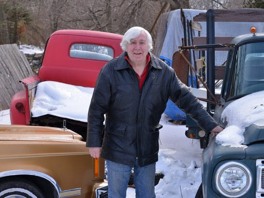 "Jerry McSpirit with the red truck behind him  used on the TV series ""Sanford & Son. Jerry  has been providing antique cars and t"