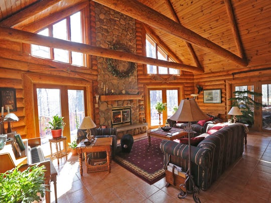 The home's great room has a cathedral ceiling and a floor-to-ceiling fireplace.