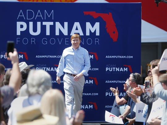 Florida Agriculture Commissioner Adam Putnam walks out to greet his supporters during his campaign rally as he kicks off his gubernatorial campaign at the Old Polk County Courthouse in Bartow, Fla., Wednesday, May 10, 2017. Workforce development, job training and education are what Putnam says are his top priorities as the Republican runs for governor. (Octavio Jones/Tampa Bay Times via AP)
