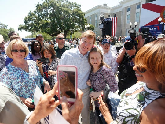 Florida Agriculture Commissioner Adam Putnam poses for a picture with Hannah Scionti, 18, during a campaign rally as he kicks off his gubernatorial campaign at the Old Polk County Courthouse in Bartow, Fla., Wednesday, May 10, 2017. Workforce development, job training and education are what Putnam says are his top priorities as the Republican runs for governor. (Octavio Jones/Tampa Bay Times via AP)