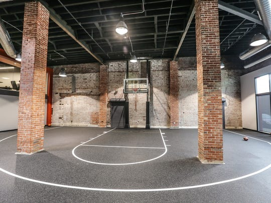 A half basketball court for shooting around welcomes employees and guests at the new headquarters for former Colts punter Pat McAfee's newest business venture, Barstool Heartland on Tuesday, August 23, 2017.