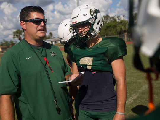 Jensen Jones played three seasons at Neumann for his father, Damon Jones (left). The coach played tight end at Lely from 1987-90 and coached the very first Broxson Trophy winner, Walner Belleus, as an assistant at Immokalee in 2000.