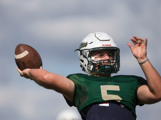 Jensen Jones, the junior quarterback for St. John Neumann High School, during practice at St. John Neumann's Monday, October 9, 2017 in East Naples. Jones, who is playing his first year at quarterback, has played a large role in leading the team to an undefeated 4-0 start to the season.