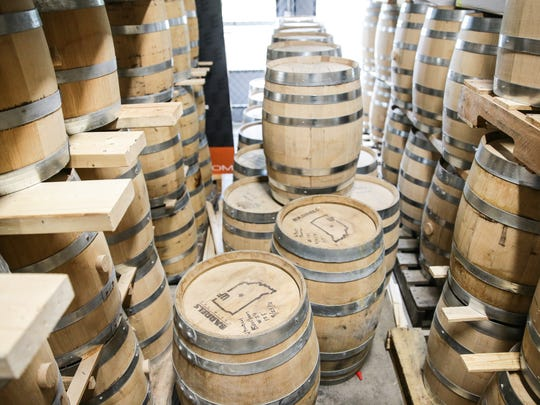 Barrels used in the production process are stacked at West Fork Whiskey Co. tasting room, 1660 Bellefontaine St. in Indianapolis on Monday, Oct. 30, 2017.