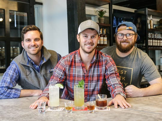 West Fork Whiskey Co. Co-founders Blake Jones, left, David McIntyre, center, and Julian Jones, right, at West Fork Whiskey Co. tasting room, 1660 Bellefontaine St. in Indianapolis on Monday, Oct. 30, 2017.