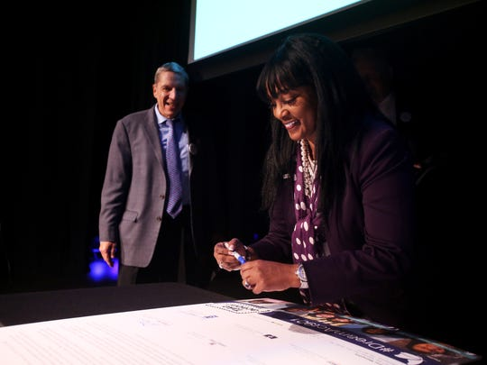 "November 15, 2017 - Dr. Andrea Miller, president of LeMoyne-Owen College, signs a letter of support for the Dream Act with other university presidents to Senators Bob Corker, Lamar Alexander, and David Kustoff during ""The future of DACA, an analysis and panel discussion about the Dream Act"" at the Halloran Centre on Wednesday."