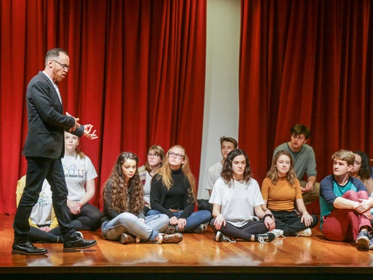 Actors in the Young Actors Theatre take instruction from Executive Director Justin Wade, left, during a rehearsal, which included self empowerment theater, at the Indianapolis Museum of Art at Newfields on Dec. 2, 2017.