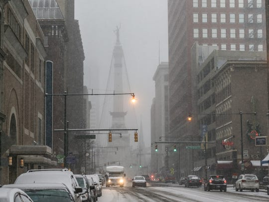 Roads turn slick and icy as snow falls in Indianapolis