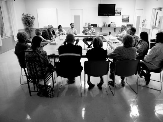 In this file photo from 2010, a weekly meeting of the