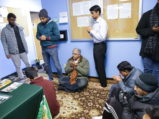 Worshippers pray in the hallway and overflow rooms at the Al Salam Foundation worship center in Indianapolis on Friday, Jan. 5, 2018. Board members hope a proposed new center in Carmel would provided much needed space for the congregation.