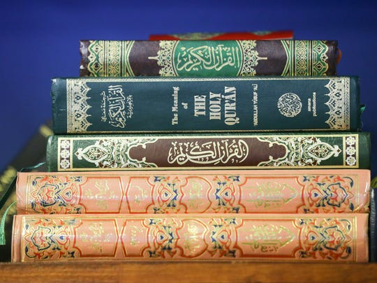 """A book titled """"The Meaning of the Holy Qur'an"""" sits on a shelf at Al Salam Foundation worship center in Indianapolis on Friday, Jan. 5, 2018."""