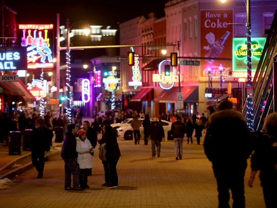 January 19, 2018 - People mingle on Beale St. during