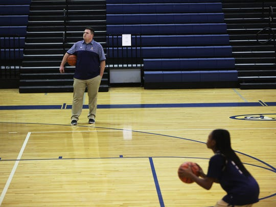 January 22, 2018 - Head coach Wesley Shappley watches his varsity girls basketball team practice at Arlington High School on Monday afternoon.