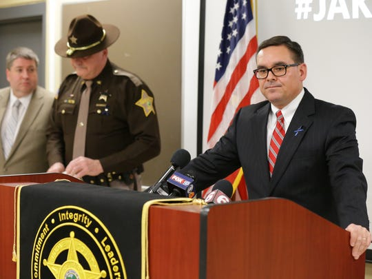 Then-Chief Deputy Prosecutor Kent Eastwood, far left, standsin the background as his boss Boone County Prosecutor Todd Meyer announces charges against a man accused of killing Boone County Deputy Jacob Pickett during a news conference on March 6, 2018. Meyer stepped down and Eastwood was appointed to take his place on June 25, 2018.